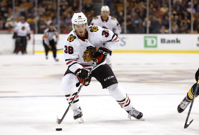 "Chicago Blackhawks' <a class=""link rapid-noclick-resp"" href=""/nhl/players/6009/"" data-ylk=""slk:Ryan Hartman"">Ryan Hartman</a> is among the players to impress early in the season. (AP Photo/Winslow Townson)"