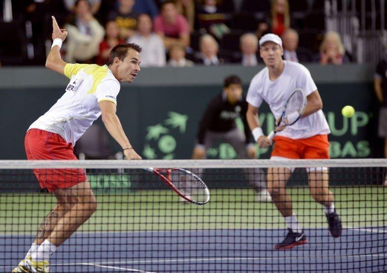 Tomas Berdych (R) and Lukas Rosol play during their Davis Cup match in Geneva on February 2, 2013