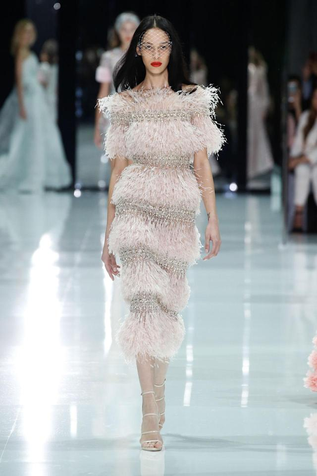 <p>Model wears a multi-tier, pink feather and crystal dress from the Ralph & Russo SS18 Haute Couture show. (Photo: Getty Images) </p>