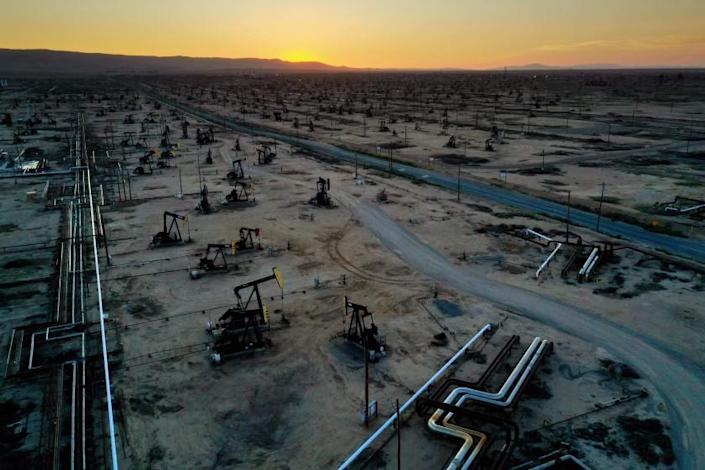 """The McKittrick oil field in the town of McKittrick in Kern County on State Route 33, has over 1,100 producing wells. With the falling price of oil, some pump jacks that need repair are being left idle. <span class=""""copyright"""">(Carolyn Cole / Los Angeles Times)</span>"""