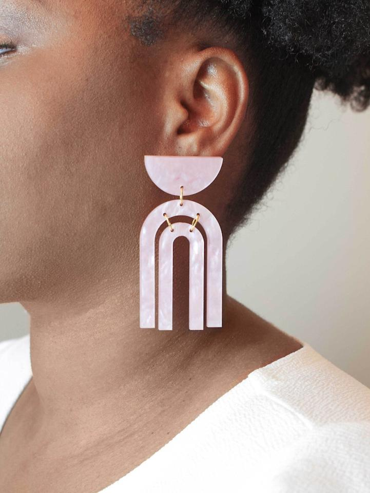 """<p>Laser-cut from durable yet lightweight acrylic, these geometric earrings from <a href=""""http://www.awin1.com/cread.php?awinmid=6220&awinaffid=272513&clickref=RS%2C7Black-OwnedEtsyShopstoSupport%25E2%2580%2594AndFindGiftsEveryoneWillLove%2Ckholdefehr1271%2CDEC%2CIMA%2C694835%2C202003%2CI&p=https%3A%2F%2Fwww.etsy.com%2Fshop%2FMyMoonSeeds%3Fref%3Dsimple-shop-header-name%26listing_id%3D730588630"""" target=""""_blank"""">My Moon Seeds</a> will stand out, without weighing you down. Available in various shapes and colors, these are currently on the top of our birthday gifts wishlist. </p> <p><strong>To buy: </strong>$35, <a href=""""http://www.awin1.com/cread.php?awinmid=6220&awinaffid=272513&clickref=RS%2C7Black-OwnedEtsyShopstoSupport%25E2%2580%2594AndFindGiftsEveryoneWillLove%2Ckholdefehr1271%2CDEC%2CIMA%2C694835%2C202003%2CI&p=https%3A%2F%2Fwww.etsy.com%2Flisting%2F730588630%2Fpink-modern-arch-statement-earrings%3F"""" target=""""_blank"""">etsy.mymoonseeds.com</a>. </p>"""