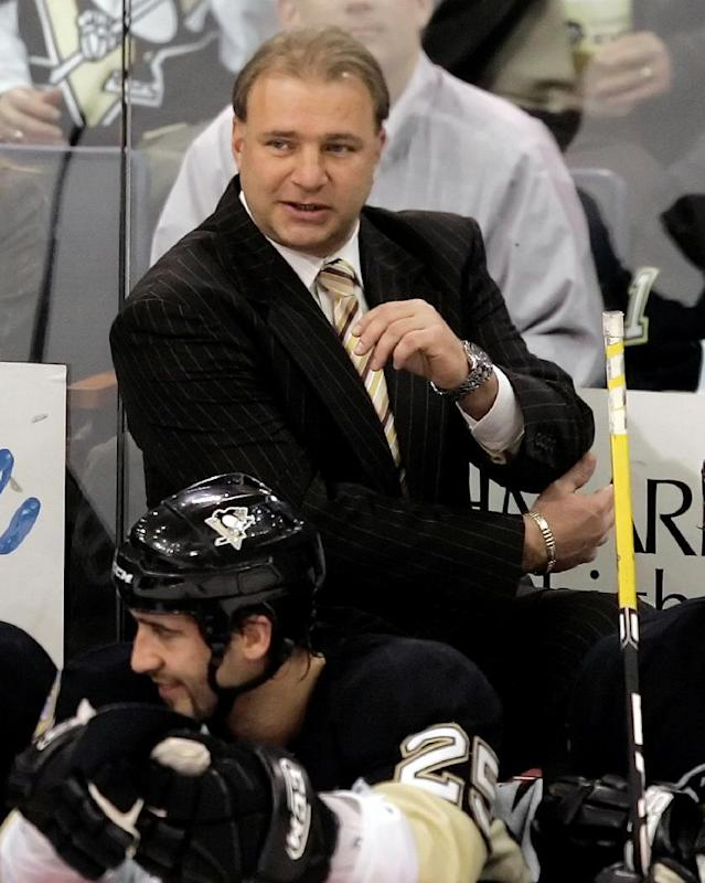 Pittsburgh Penguins coach Michel Therrien works behind the bench against the New York Rangers in NHL hockey action at Pittsburgh Monday, Jan. 14, 2008. The Penguins won 4-1. (AP Photo/Gene J. Puskar)