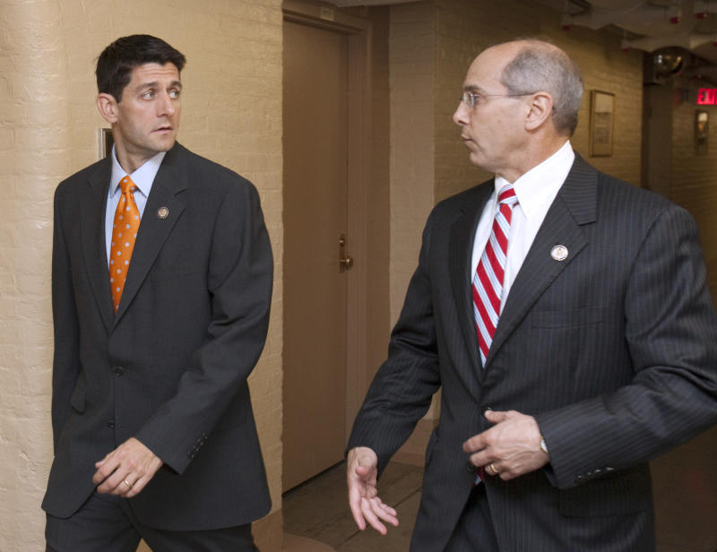 House Budget Committee Chairman Rep. Paul Ryan, R-Wis., left, walks with Rep. Charles Boustany, R-La., as they arrive for a House GOP caucus on Capitol Hill in Washington, Thursday, June 2, 2011. (AP Photo/Harry Hamburg)