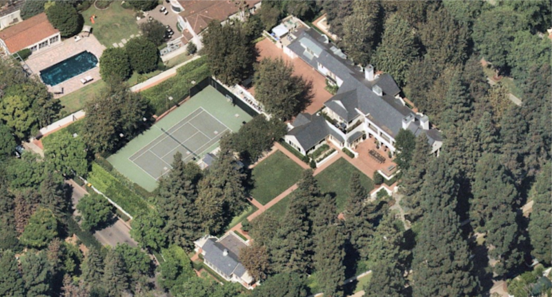 The two-acre spread includes a 1940s home, guesthouse, swimming pool, tennis court and pavilion.