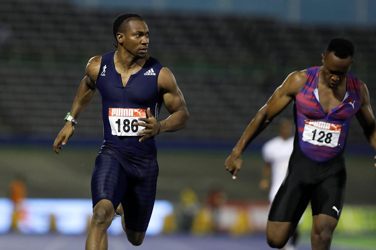 Athletics - JAAA National Senior Championships - National Stadium Kingston, Jamaica - June 23, 2017 Jamaica's Yohan Blake (L) and Julian Forte in action during the Men's 100m final REUTERS/Lucy Nicholson