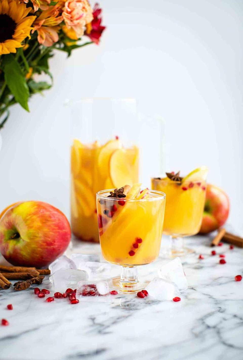 """<p>Sangria fans will love this white wine version that's packed with autumnal flavors like apples, cinnamon, and oranges. Give it a pop of color with a handful of pomegranate seeds. </p><p><strong>Get the recipe at <a href=""""https://www.butterbeready.com/autumn-apple-sangria/"""" rel=""""nofollow noopener"""" target=""""_blank"""" data-ylk=""""slk:Butter Be Ready"""" class=""""link rapid-noclick-resp"""">Butter Be Ready</a>. </strong></p><p><a class=""""link rapid-noclick-resp"""" href=""""https://go.redirectingat.com?id=74968X1596630&url=https%3A%2F%2Fwww.walmart.com%2Fsearch%2F%3Fquery%3Dbar%2Btools&sref=https%3A%2F%2Fwww.thepioneerwoman.com%2Fholidays-celebrations%2Fg36982659%2Fhalloween-drink-recipes%2F"""" rel=""""nofollow noopener"""" target=""""_blank"""" data-ylk=""""slk:SHOP BAR TOOLS"""">SHOP BAR TOOLS </a></p>"""