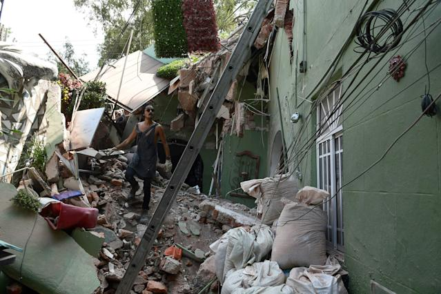 <p>A man walks over the rubble of a house badly damaged by a quake in Mexico City on September 19, 2017.<br> A powerful earthquake shook Mexico City on Tuesday, causing panic among the megalopolis' 20 million inhabitants on the 32nd anniversary of a devastating 1985 quake. The US Geological Survey put the quake's magnitude at 7.1 while Mexico's Seismological Institute said it measured 6.8 on its scale. The institute said the quake's epicenter was seven kilometers west of Chiautla de Tapia, in the neighboring state of Puebla.<br> (Photo: Ronaldo Schemidt/AFP/Getty Images) </p>