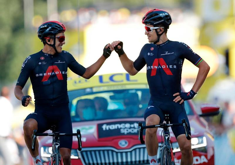 Ineos Grenadier' Michal Kwiatkowski (right) celebrates as he crosses the finish line ahead of teammate Richard Carapaz during the 18th stage between Meribel and La Roche sur Foron,