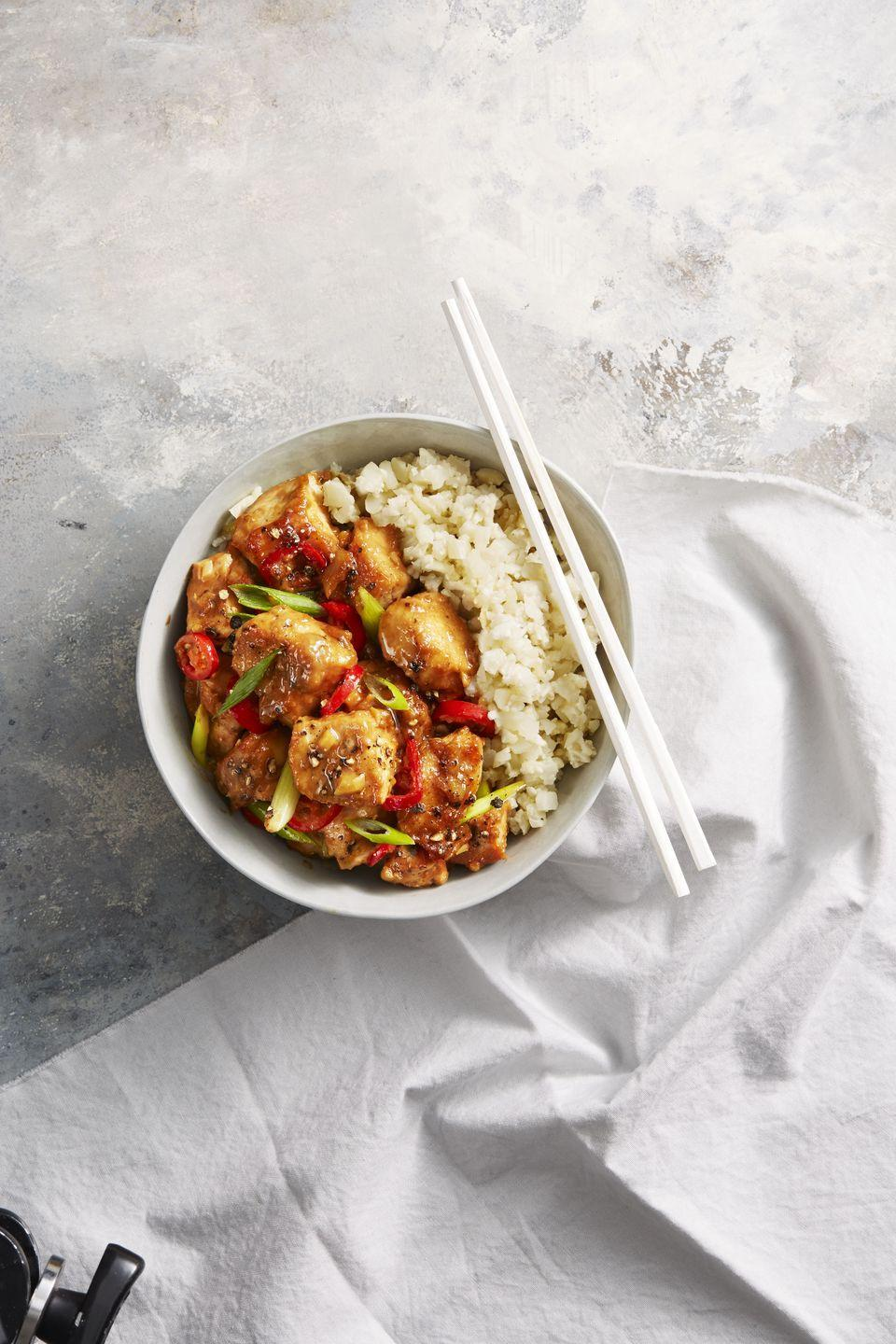 """<p>This bowl is low in carbs and huge on flavor thanks to a magical little thing called cauliflower rice.</p><p><a href=""""https://www.goodhousekeeping.com/food-recipes/healthy/a42219/spicy-chicken-miso-stir-fry-recipe/"""" rel=""""nofollow noopener"""" target=""""_blank"""" data-ylk=""""slk:Get the recipe for Spicy Miso Chicken Stir-Fry »"""" class=""""link rapid-noclick-resp""""><em>Get the recipe for Spicy Miso Chicken Stir-Fry »</em></a><br></p>"""