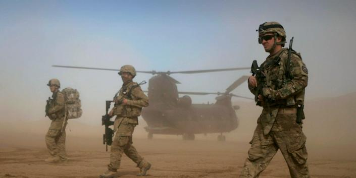 U.S. soldiers, part of the NATO- led International Security Assistance Force (ISAF) patrol west of Kabul, Afghanistan.
