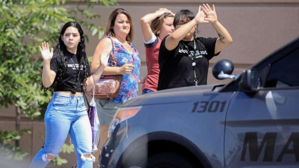 PHOTO: Shoppers exit with their hands up after a mass shooting at a Walmart in El Paso, Texas, Aug. 3, 2019. (Reuters)