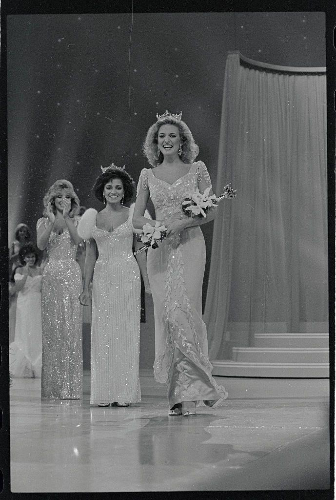<p>With big hair and this beaded dress, Sharlene Wells from Utah was an '80s dream when she took her victory lap across the stage. </p>