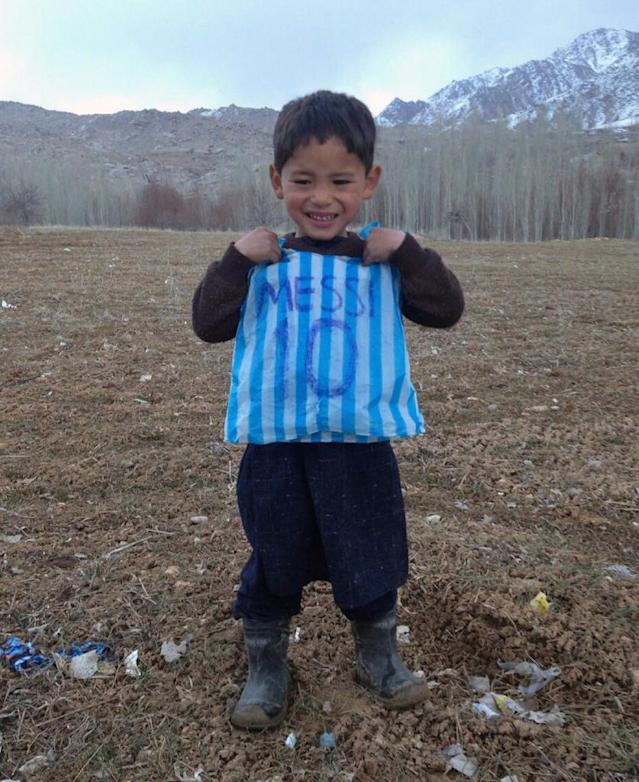 Murtaza Ahmadi's brother made him a makeshift jersey out of a blue and white striped plastic bag, with Messi's name and famous number 10 written carefully on the back in felt-tip pen (AFP Photo/STR)