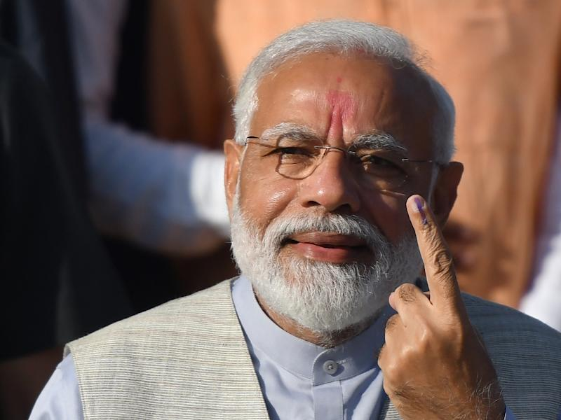 Indian Prime Minister Narendra Modi is looking to boost his chances of a second term as the national election heads into its final round (AFP Photo/PUNIT PARANJPE)