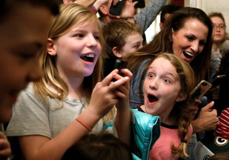 A young girl reacts after Trump made a surprise appearance in front of her White House tour group on Tuesday. (Kevin Lamarque/Reuters)