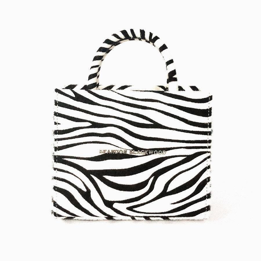 "<p>This New York City-based accessories designer, whose creations have gone viral, thanks to Kim Kardashian, makes playful and functional handbags for those who love to make a major statement. The Brandon Blackwood Zebra Mini Tote could make <em>anyone</em> squeal with excitement.</p> <p><strong>$145</strong> (<a href=""https://www.brandonblackwood.com/shop-2/goqdna09ynrxonklwox5a0bkfhobae"" rel=""nofollow noopener"" target=""_blank"" data-ylk=""slk:Shop Now"" class=""link rapid-noclick-resp"">Shop Now</a>)</p>"