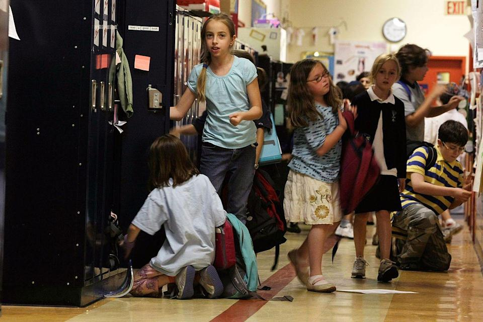 <p>Students make some final trips to their lockers before going home for the night at a school in Washington D.C. </p>