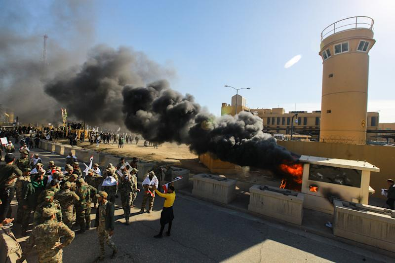 Iraqi Shiite militia supporters burn property during a demonstration inside the US Embassy compound in Baghdad on Dec. 31, 2019. (Photo: Ameer Al Mohmmedaw/picture alliance via Getty Images)