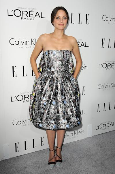 "Actress Marion Cotillard arrives at the ELLE 20th annual ""Women in Hollywood"" event at the Four Seasons Hotel on Monday, Oct. 21, 2013 in Los Angeles. (Photo by Jordan Strauss/Invision/AP)"