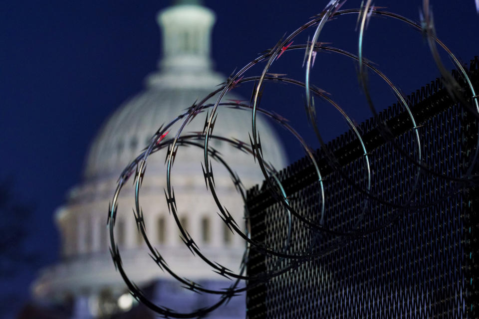 In this Jan. 19, 2021 photo, riot fencing and razor wire reinforce the security zone on Capitol Hill in Washington. The Capitol Police say they are stepping up security at Washington-area transportation hubs and taking other steps to bolster travel security for lawmakers. The moves come as Congress continues to react to this month's deadly assault on the Capitol. (AP Photo/J. Scott Applewhite)