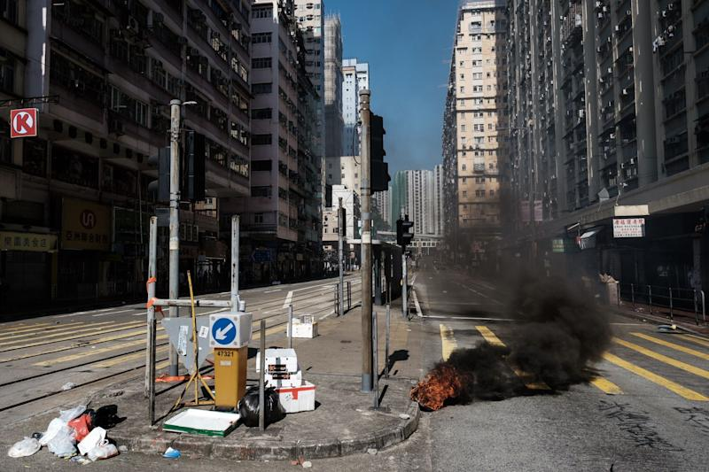 Hong Kong Banks Send Some Staff Home as Tear Gas Wafts Outside