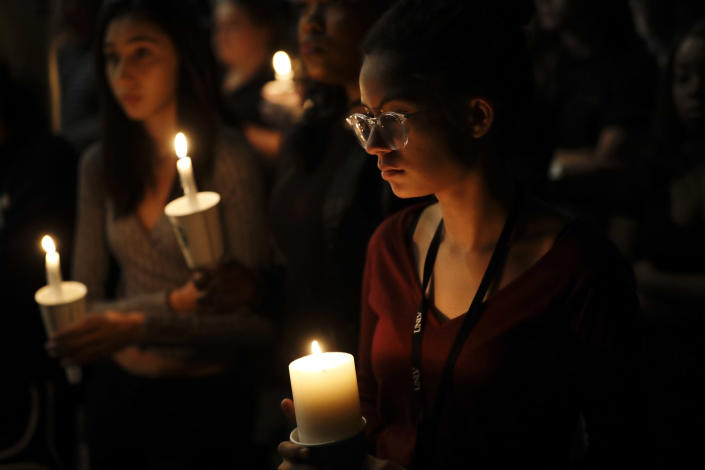 <p>Natalynn Rivis, a student at University of Nevada Las Vegas, right, takes part in a vigil Monday, Oct. 2, 2017, in Las Vegas. A gunman on the 32nd floor of the Mandalay Bay casino hotel rained automatic weapons fire down on the crowd of over 22,000 at an outdoor country music festival Sunday. (Photo: Gregory Bull/AP) </p>