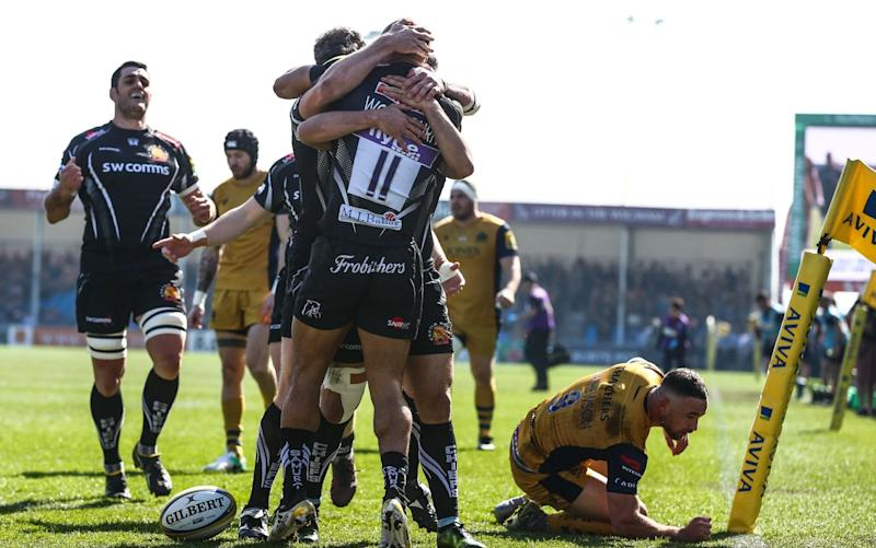 Olly Woodburn of Exeter Chiefs celebrates going over for his try against Bristol - Rex Features
