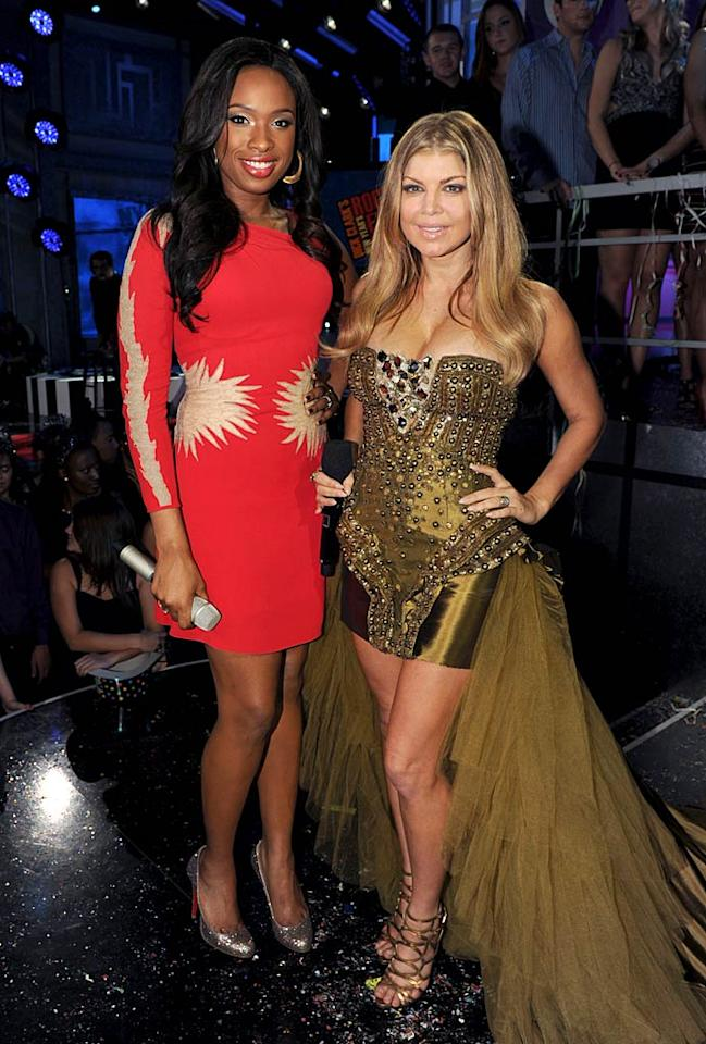 """At Dick Clark's New Year's Rockin' Eve, Jennifer Hudson accentuated her shrinking waistline in a red-hot dress, while fellow diva/Black Eyed Peas frontwoman Fergie stepped forward in a strapless studded mini, which featured a tulle train. Kevin Winter/DCNYRE2011/<a href=""""http://www.gettyimages.com/"""" target=""""new"""">GettyImages.com</a> - December 31, 2010"""