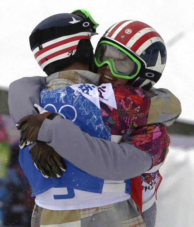 Alex Deibold of the United States, left, embraces Trevor Jacob of the United States after the men's snowboard cross semifinal at the Rosa Khutor Extreme Park, at the 2014 Winter Olympics, Tuesday, Feb. 18, 2014, in Krasnaya Polyana, Russia. (AP Photo/Andy Wong)