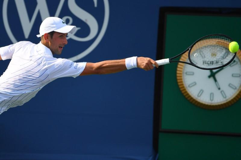 Djokovic rolls on at Western and Southern Open, Murray eliminated
