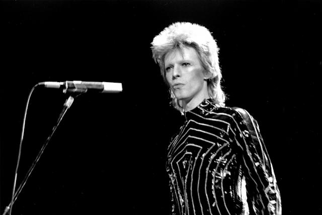<p>When David Bowie died on January 8 at age 69, the world lost a true icon. His glamorous, androgynous style influenced music and culture for decades. — (Pictured) Musician David Bowie performs onstage in 1973 in Long Beach, California. (Michael Ochs Archives/Getty Images) </p>