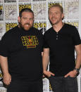 """File - In this July 19, 2013 file photo, Nick Frost, left, and Simon Pegg attend """"The World's End"""" press line on Day 3 of Comic-Con International in San Diego. It's not the end of the world, but """"The World's End"""" marks a creative conclusion for actors Pegg, Frost, and director, Edgar Wright. The threesome behind """"Shaun of the Dead"""" and """"Hot Fuzz"""" say """"The World's End,"""" in theaters Friday, Aug. 23, 2013, completes a trilogy. (Photo by Chris Pizzello/Invision/AP, File)"""