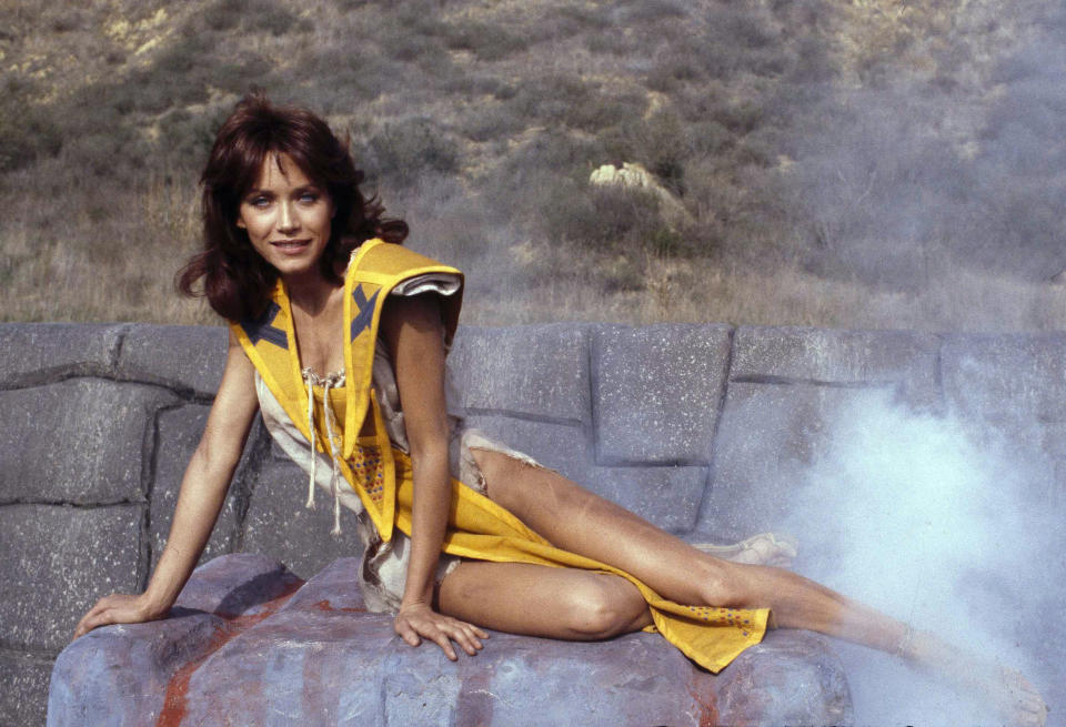 """FILE - Tanya Roberts stars as Kiri in the adventure movie """"The Beastmaster,"""" on Dec. 16, 1981. Roberts, who captivated James Bond in """"A View to a Kill"""" and had roles on """"Charlie's Angels"""" and """"That '70s Show,"""" died Sunday, Jan. 3, 2021. She was 65. Her death was announced by her publicist. No cause of death was given. (AP Photo/Wally Fong, File)"""