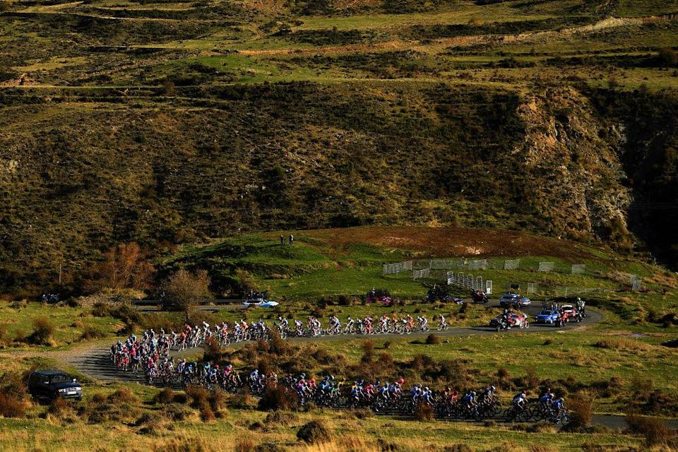ALTODEMONCALVILLO SPAIN  OCTOBER 28 Richard Carapaz of Ecuador and Team INEOS  Grenadiers Red Leader Jersey  Peloton  Landscape  Autumn  during the 75th Tour of Spain 2020 Stage 8 a 164km stage from Logroo to Alto de Moncalvillo 1490m  lavuelta  LaVuelta20  on October 28 2020 in Alto de Moncalvillo Spain Photo by David RamosGetty Images