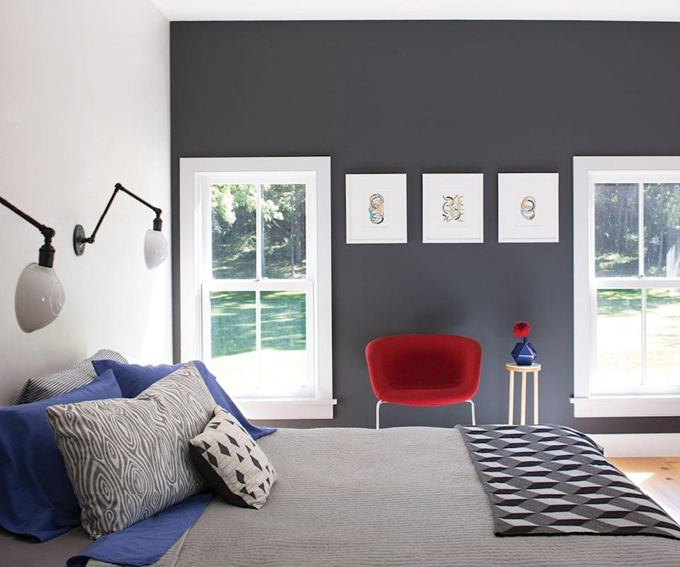 """<p>If you feel grey will dominate your bedroom, just paint one wall and choose a soft, warm charcoal that has a touch of pink in it. Set it off with white painted window frames and a trio of prints, then bring in more grey and pattern with the bedding.</p><p>Pictured: Arctic Seal shade with Perspective on the left wall, both flat emulsion, from <a href=""""https://www.benjaminmoorepaint.co.uk/"""" rel=""""nofollow noopener"""" target=""""_blank"""" data-ylk=""""slk:Benjamin Moore"""" class=""""link rapid-noclick-resp"""">Benjamin Moore</a></p>"""