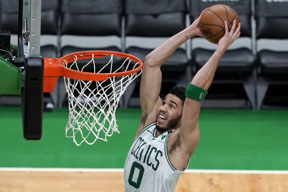 Boston Celtics forward Jayson Tatum (0) dunks against the Brooklyn Nets in the second half of Game 4 during an NBA basketball first-round playoff series, Sunday, May 30, 2021, in Boston. (AP Photo/Elise Amendola)