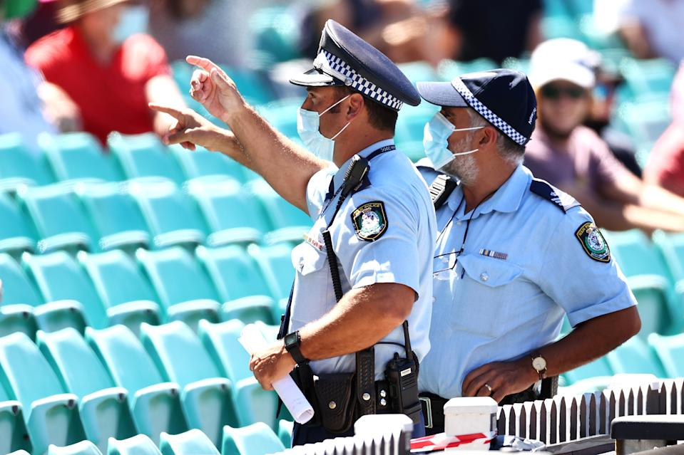 SYDNEY, AUSTRALIA - JANUARY 10: Police monitor the crowd following a complaint by Mohammed Siraj of India about spectators during day four of the Third Test match in the series between Australia and India at Sydney Cricket Ground on January 10, 2021 in Sydney, Australia. (Photo by Cameron Spencer/Getty Images)
