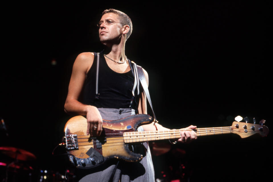 "PONTIAC, MI - APRIL 30: English-born Irish musician who is the bass guitarist for U2, Adam Clayton performs during ""The Joshua Tree Tour"" on April 30, 1987, at the Pontiac Silverdome in Pontiac, Michigan. (Photo by Ross Marino/Getty Images)"