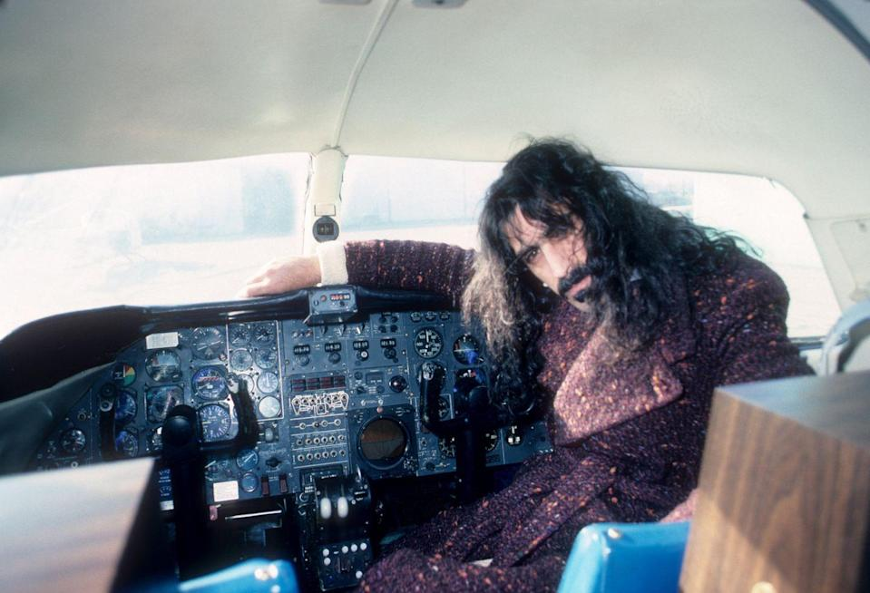 <p>Frank Zappa sits in the cockpit of an airplane in Detroit in 1976. </p>
