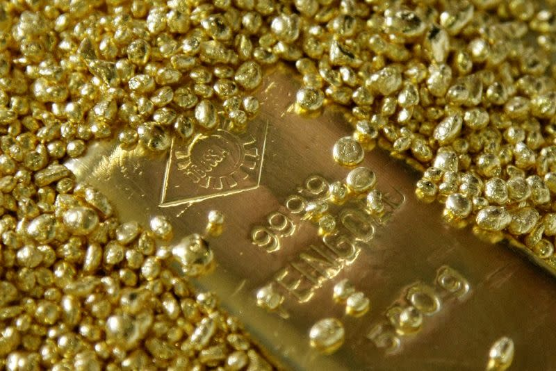 Gold gains above $1,800/oz as infection cases mount