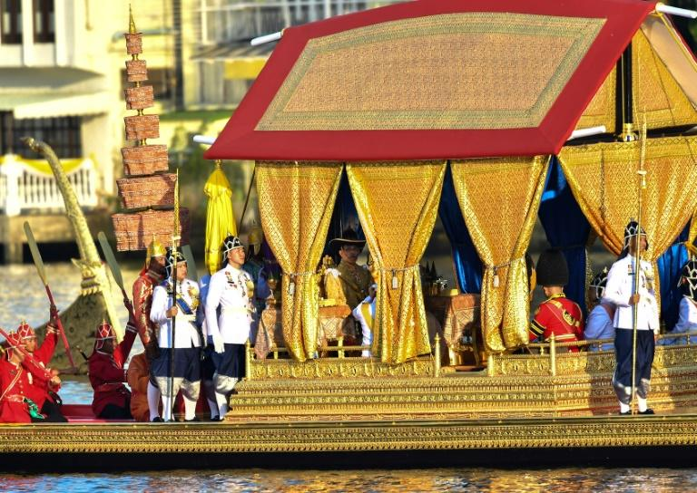 King Maha Vajiralongkorn and Queen Suthida passed by on a gilded Suphannahong - or 'Golden Swan' - barge