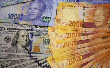 Photo illustration of South African bank notes displayed next to the American dollar notes in Johannesburg