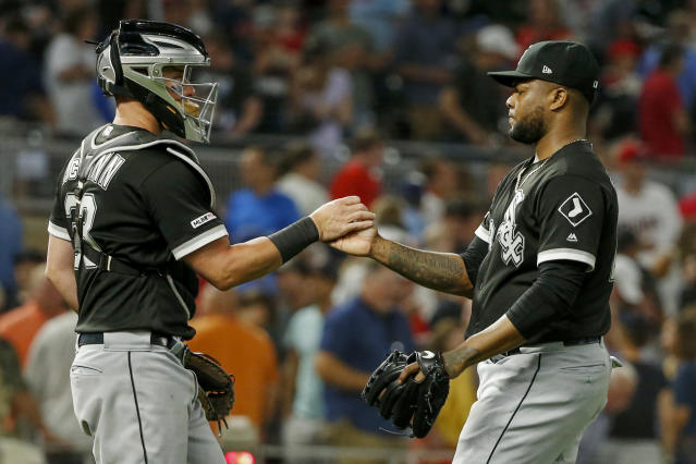 Chicago White Sox catcher James McCann (33) celebrates with Alex Colome as the team defeated the Minnesota Twins in a baseball game, Monday, Aug. 19, 2019, in Minneapolis. The White Sox won 6-4. (AP Photo/Bruce Kluckhohn)