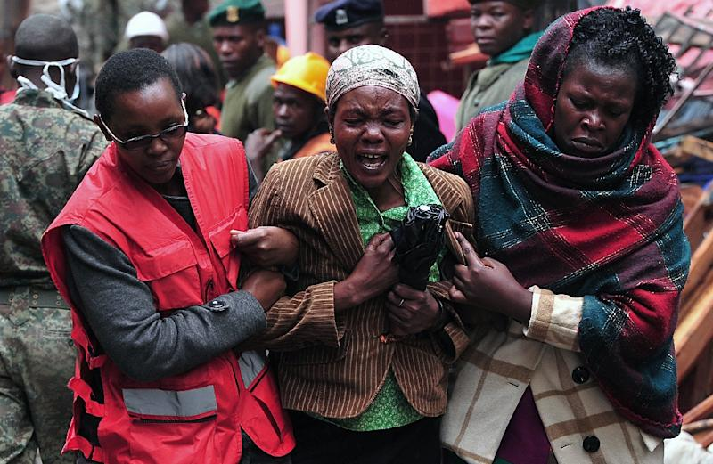 A woman mourns the loss of a relative after a building collapse in Kenya's capital Nairobi on April 30, 2016