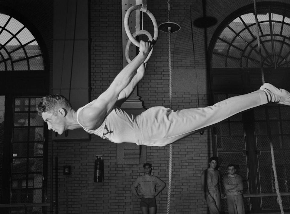 <p>This photo from 1942 shows a gymnast on rings at the U.S. Naval Academy in Annapolis, Maryland. The gymnastics rings were popular in the '40s. <br></p>