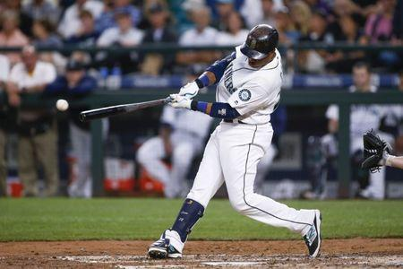 Aug 23, 2016; Seattle, WA, USA; Seattle Mariners second baseman Robinson Cano (22) hits a single against the New York Yankees during the fourth inning at Safeco Field. Mandatory Credit: Joe Nicholson-USA TODAY Sports / Reuters Picture Supplied by Action Images