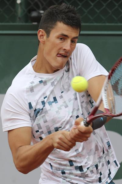 CAPTION CORRECTS NAME OF PLAYER Australia's Bernard Tomic returns the ball to Romania's Victor Hanescu, during their first round match at the French Open tennis tournament, at Roland Garros stadium in Paris, Tuesday, May 28, 2013. (AP Photo/Michel Euler)