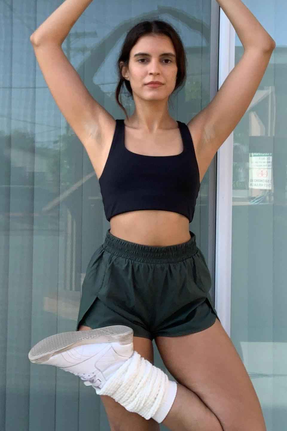 """<p>""""I was secretly dreading the onset of spring and summer because I have absolutely no idea what to wear for warmer WFH weather. The moment it becomes a degree too hot for sweatpants, I'm lost. Luckily, I hunted down these <span>Girlfriend Collective Moss Trail Short</span> ($55) that seem to be the perfect solution to my work-from-home woe. Sure, most people would opt for these shorts to go on a humid morning run, but I'm thinking they'll be just as comfy parked at my desk."""" - Samantha Sasso, editor, Branded Content</p>"""