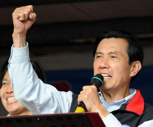 Taiwan President Ma Ying-jeou clinches his fist as he campaigns for re-election in Hsinchu on January 10, 2012 ahead of the January 14 presidential election