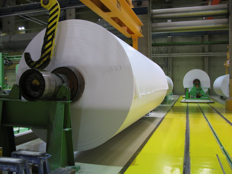 FILE PHOTO: Magazine paper rolls are seen at UPM-Kymmene's paper mill in Kaukas, Lappeenranta
